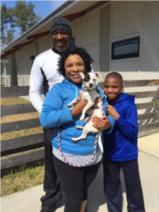 The Walker family, which volunteers at the shelter on Saturdays, adopted little Anya.