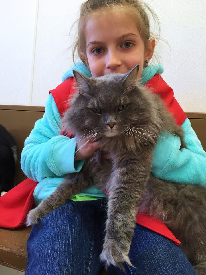 Young  FOTAS volunteer Holly Heiens with Munchkin the cat