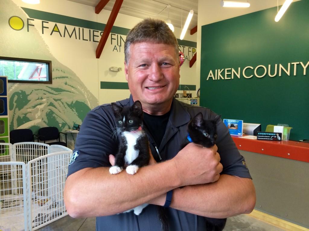 Bobby Arthurs, Aiken County Animal Shelter manager, holds Ricky and Turner