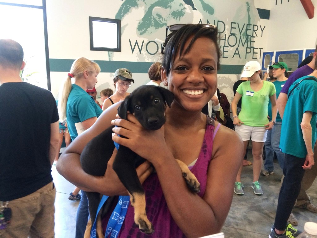 Patricia Rameau of Aiken adopts Robin, a hound puppy, on Clear the Shelters day.