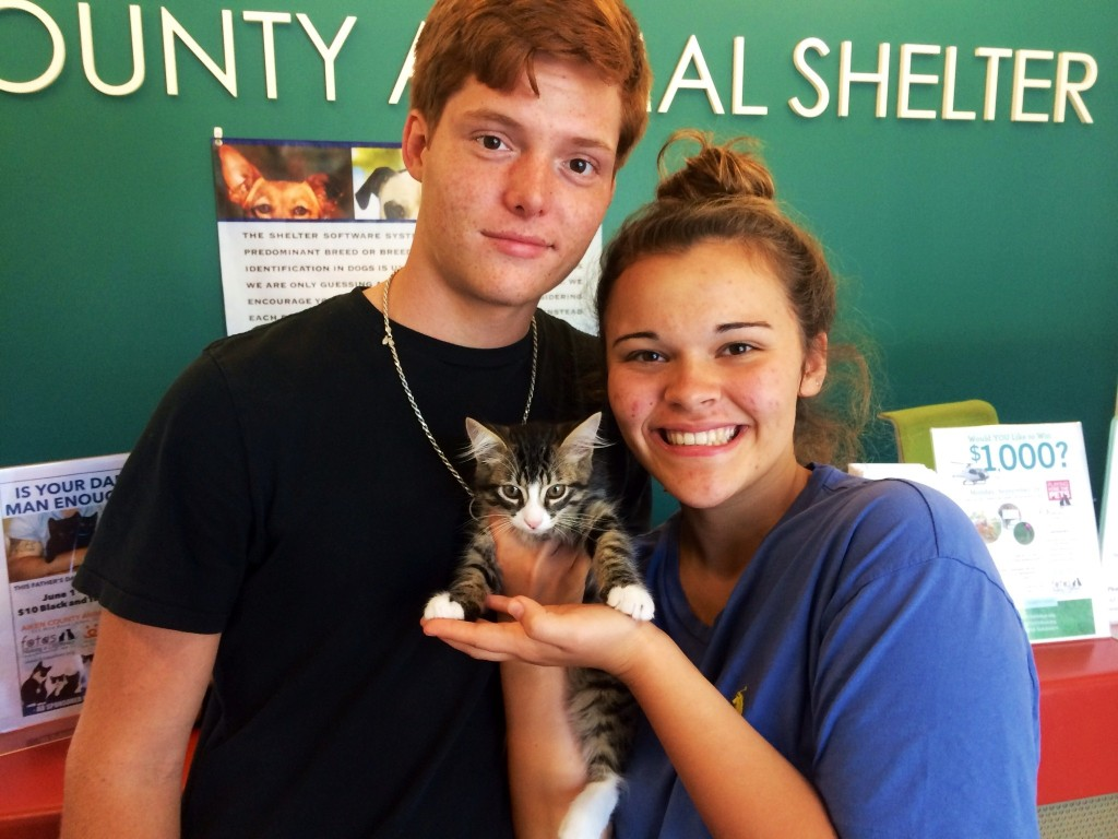 Sloan Lindler and Lori Duran of Aiken picked handsome 3-month-old Simba (and he picked them) for adoption.