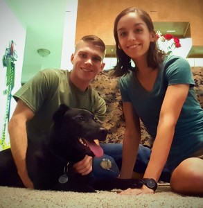 Marines Tom Buchanan and Taylor Heimann with their adopted dog, Heidi