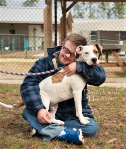 FOTAS Volunteer Derek DeMio hugs Harrison, a Retriever mix who has since been adopted