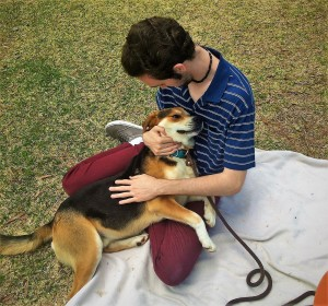 DAMON HELPS A STUDENT RELAX DURING USC AIKEN PET A PUP EVENT