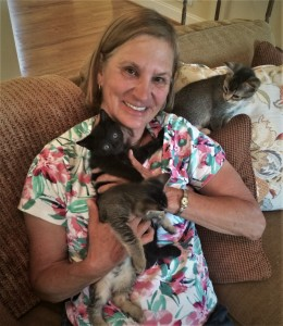 FOTAS Volunteer Debbie Snyder at home with her three foster kittens.