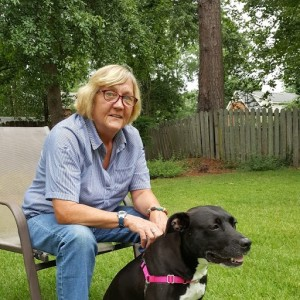 Patty McDonagh and her new canine companion, Roxy, relax in their backyard.