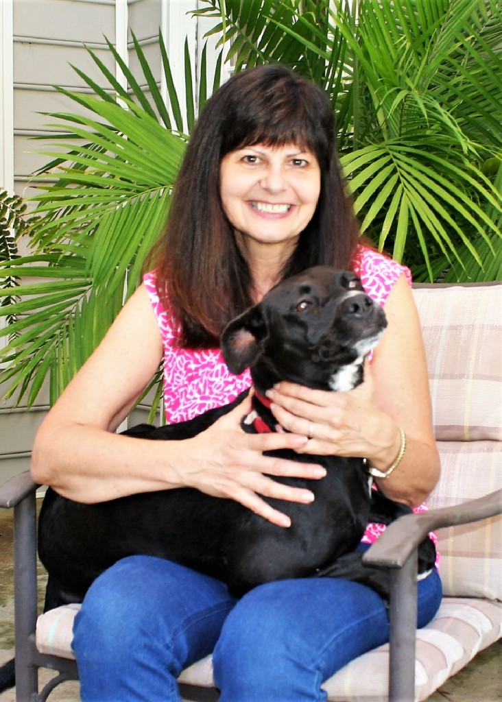 Dr. Lisa Levy at home with her three-legged family member, Trinity.