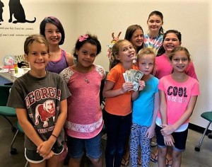 Birthday girl Audrey Dietzel (holding cash donation) hosted her birthday party at the Coun