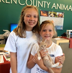 Sisters Rheney and Robbie Bates donated their own money to FOTAS and adopted Cotton.
