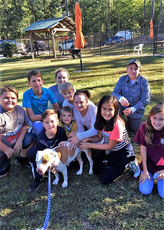 Tall Pines STEM Academy students visit the Aiken County Animal Shelter to learn more about FOTAS.  Students include: Karylle Hambrick, Dylan Seeley, Kahlei Morris, Noah Jacobs, Christian Grove, Gabey Marshall, Blake Scott and Sydney Ledere