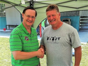 Bobby and Aiken County Council Chairman Gary Bunker catch up at a Shelter adoption event.