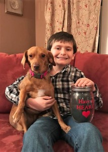 Nine-year-old Alex Mastromonico with his adopted dog, Bailee.