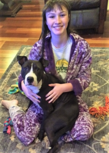 Becca Babineau at home with foster dog, Max.