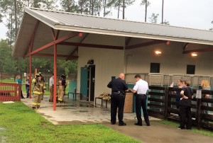 Aiken Public Safety clears the smoke and assesses fire damage in the first pod of the Shelter's adoption wing.