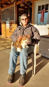 Diane Mansur with her adopted barn cat and super mouser, Callie.