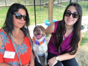Volunteers Olga and Nicole Simons with their latest photo shoot model, Ginger.